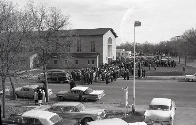 Crowds outside church during the Clutter family funeral. (Photo: SundanceTV/RadicalMedia)