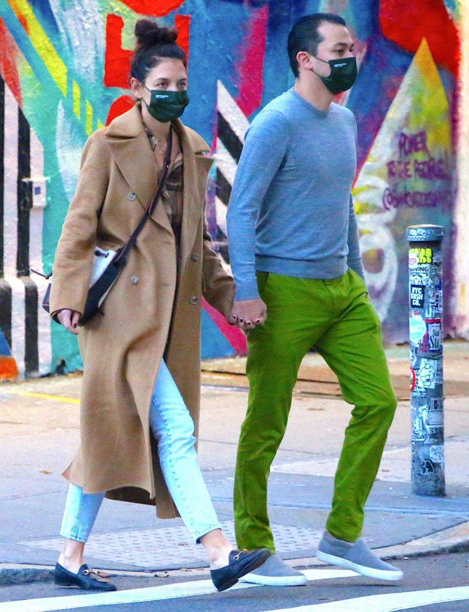 <p>Katie Holmes and boyfriend Emilio Vitolo Jr. hold hands as they walk to his restaurant in N.Y.C.'s Soho neighborhood on Tuesday. </p>