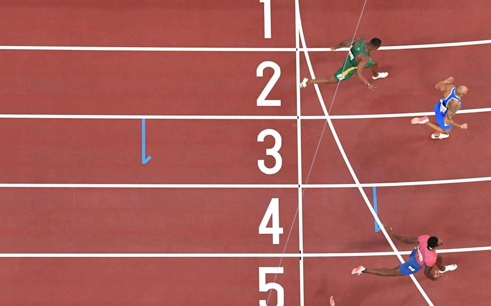 Italy's Lamont Marcell Jacobs crosses the finish line to win - AFP Getty