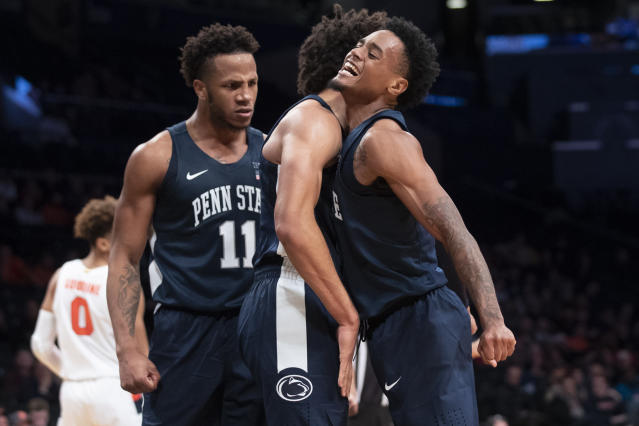 Penn State forward Lamar Stevens (11), Seth Lundy, center, and guard Curtis Jones celebrate during the final minutes in the second half of an NCAA college basketball game against Syracuse in the consolation round of the NIT Season Tip-Off tournament, Friday, Nov. 29, 2019, in New York. Penn State won 85-64. (AP Photo/Mary Altaffer)
