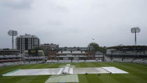 Rain covers protect the pitch, as rain delays the start of play on the third day of the Test match between England and New Zealand at Lord's cricket ground in London, Friday, June 4, 2021. (AP Photo/Kirsty Wigglesworth)