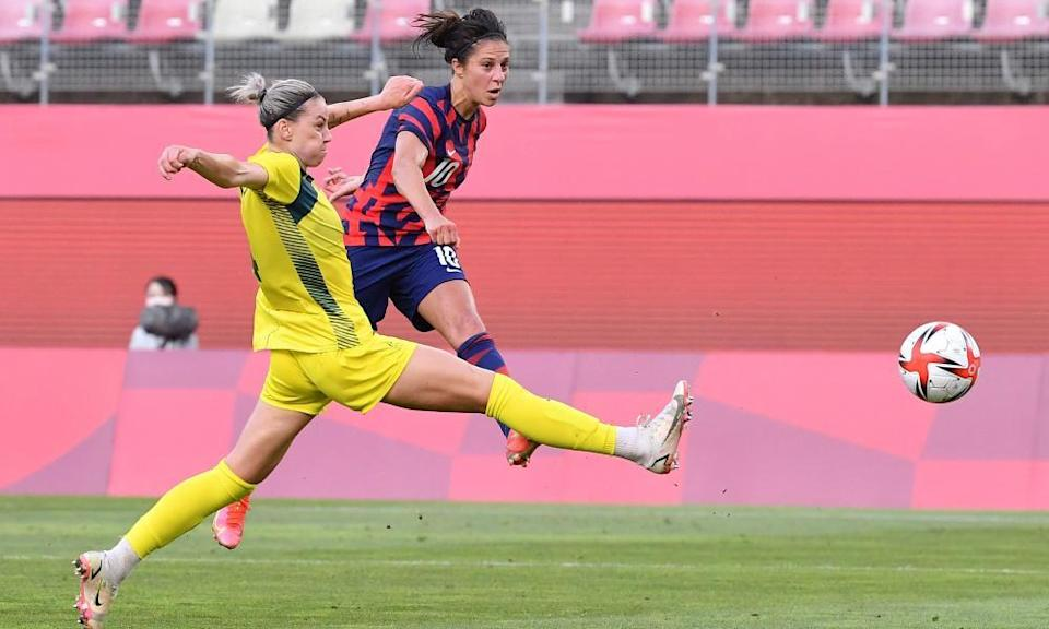 Carli Lloyd gets the better of Alanna Kennedy to score for the USA.