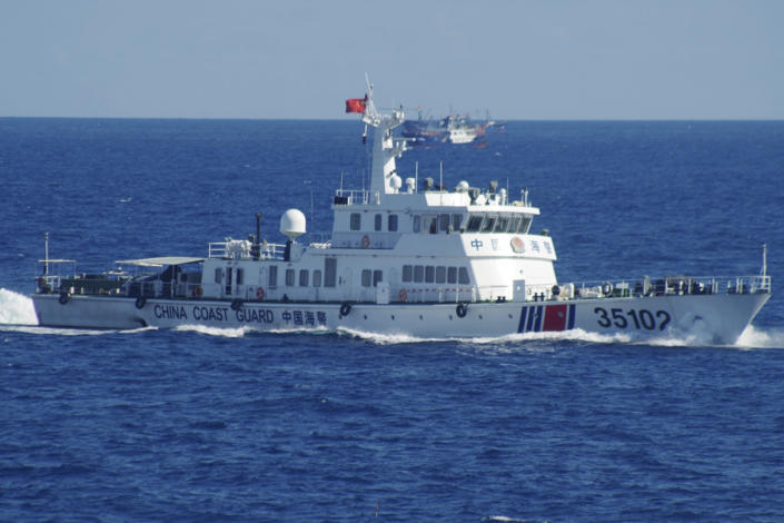 FILE - In this Aug. 6, 2016, file photo released by the 11th Regional Coast Guard Headquarters of Japan, a Chinese coast guard vessel sails near disputed East China Sea islands. China claims almost all of the South China Sea, has built military bases on artificial islands in the disputed area and routinely objects to any action by the U.S. military in the region. (11th Regional Coast Guard Headquarters via AP, File)