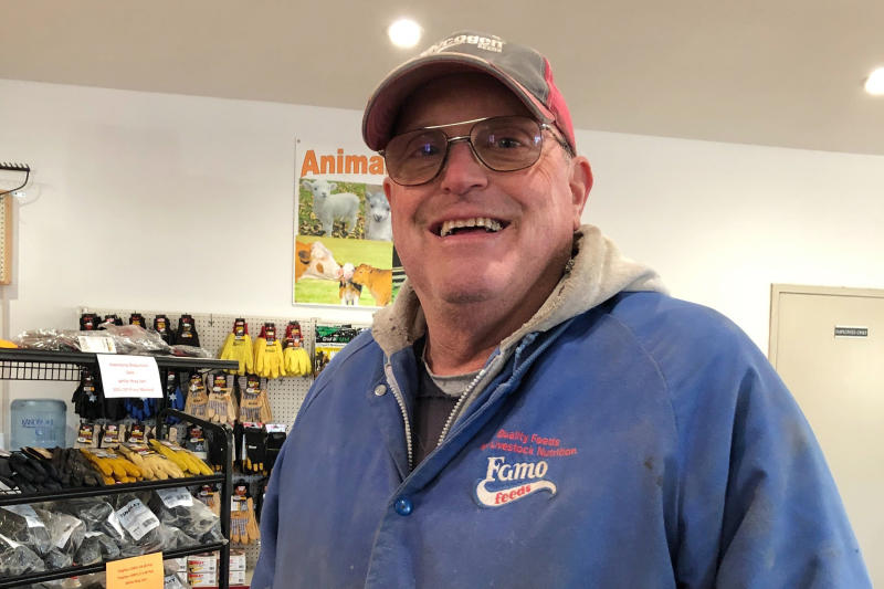 In this Nov. 21, 2019 photo, Minnesota farmer Jeff Ampe talks about impeachment and Minnesota's 7th District congressional race after dropping off a load of corn at the Feed Co. feed mill in Paynesville, Minn. Ampe, a conservative Republican, likes his incumbent Democratic congressman, House Agriculture Committee Chairman Collin Peterson. But he also likes Peterson's leading GOP challenger, former Lt. Gov. Michelle Fischbach, of Paynesville. (AP Photo/Steve Karnowski)