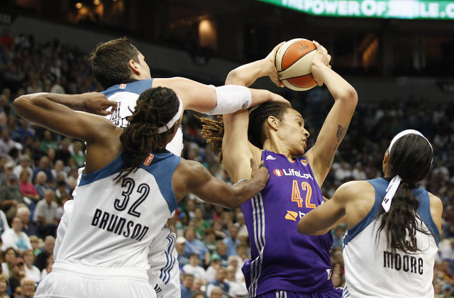 Phoenix Mercury center Brittney Griner (42) holds a rebound ball away from Minnesota Lynx forward Janel McCarville (4) during Game 1 of the WNBA basketball playoffs Western Conference finals on Thursday, Sept. 26, 2013, in Minneapolis. The Lynx won 85-62. (AP Photo/Stacy Bengs)