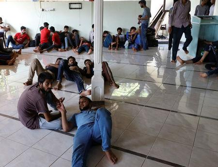 Pakistan refugees rest inside a mosque in Negombo