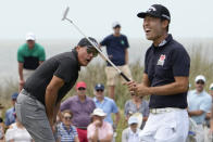 Phil Mickelson, left, misses a putt as Kevin Na, right, reacts on the 14th hole during a practice round at the PGA Championship golf tournament on the Ocean Course Wednesday, May 19, 2021, in Kiawah Island, S.C. (AP Photo/David J. Phillip)