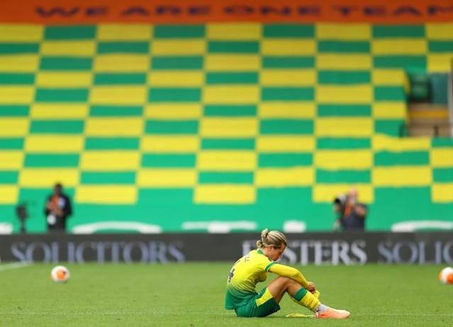 Down and out: Norwich's Todd Cantwell reacts to another defeat which leaves the Canaries ever closer to relegation from the Premier League (AFP Photo/Richard Heathcote)