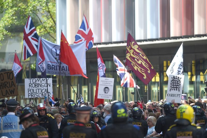 Supporters of far-right activist Tommy Robinson outside the Old Bailey in London after he was jailed last week for nine months for contempt of court (Picture: PA)