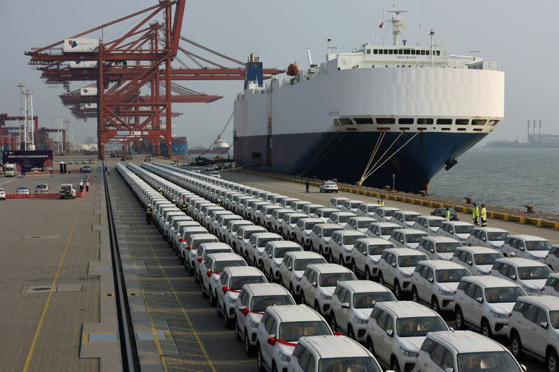 FILE PHOTO: Imported Toyota cars arrive from a cargo vessel at the Shenzhen Dachan Bay Terminals in Guangdong