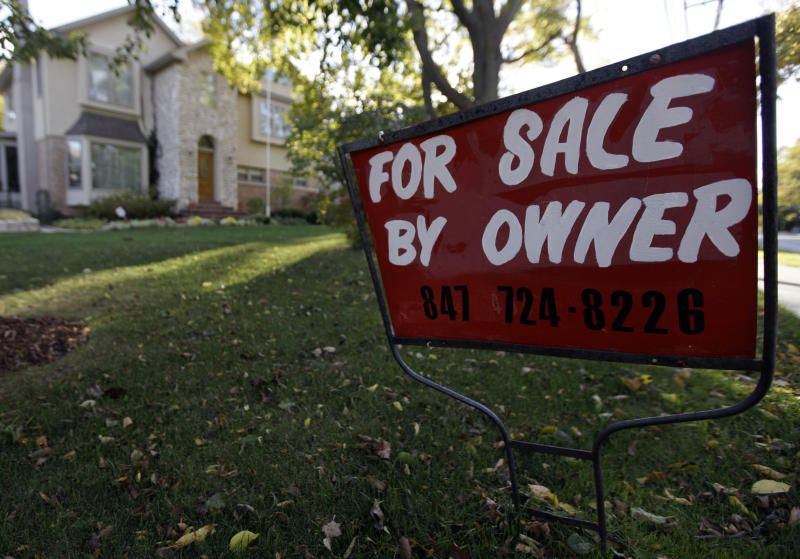 FILE - This Wednesday, Oct. 10, 2012  file photo shows a for-sale sign at a home in Glenview, Ill. U.S. sales of previously occupied homes rose solidly in October, helped by improvement in the job market and record-low mortgage rates. (AP Photo/Nam Y. Huh, File)