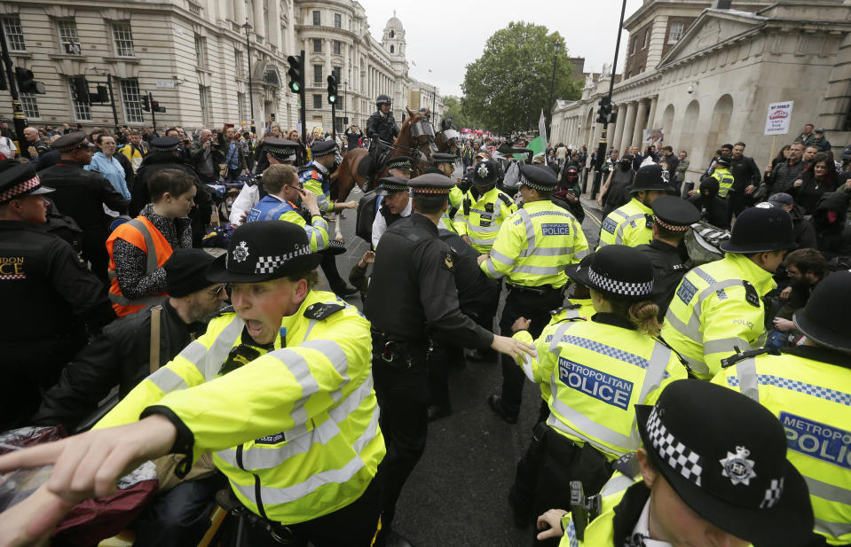 Police forces are trying to restore order after a small scuffle broke out between Donald Trump supporters and people that gathered in central London to demonstrate against the state visit of President Donald Trump. (AP Photo/Tim Ireland)