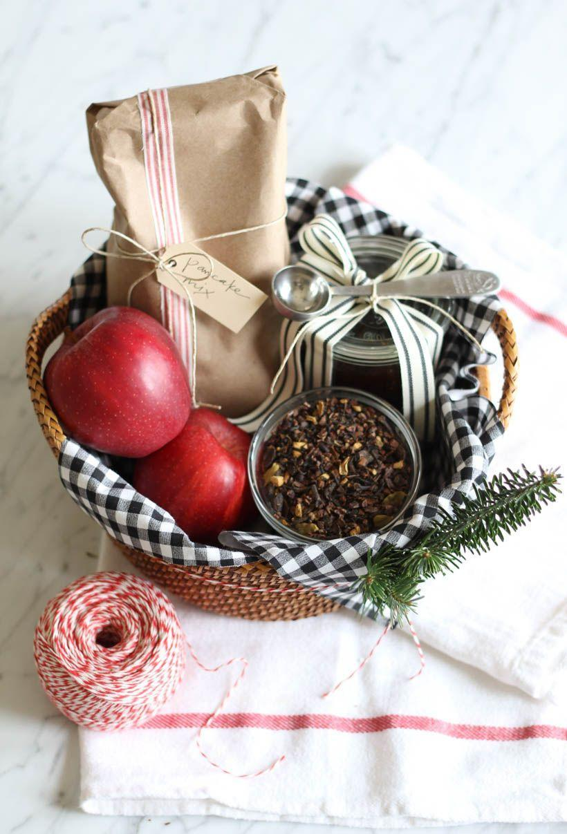 """<p>Tea is the name of the game in this sophisticated gift basket. Even the basket itself is lined with a tea towel! Include a bag of pancake mix<em><em>, </em></em>a jar of fresh jam, ripe apples, and loose-leaf tea for a gift that's as delicious as it is nice to look at.</p><p><strong>Get the tutorial at <a href=""""https://camillestyles.com/entertaining/parties/give-the-gift-of-tea/"""" rel=""""nofollow noopener"""" target=""""_blank"""" data-ylk=""""slk:Camille Styles"""" class=""""link rapid-noclick-resp"""">Camille Styles</a>.</strong> </p>"""