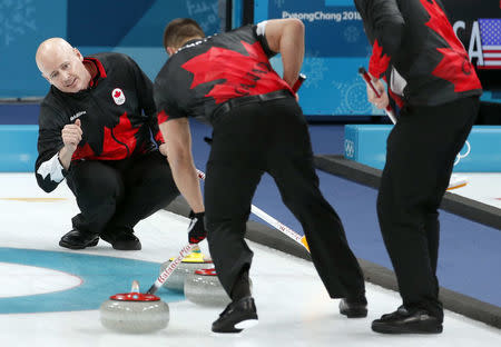 Curling - Pyeongchang 2018 Winter Olympics - Men's Semi-final - Canada v U.S. - Gangneung Curling Center - Gangneung, South Korea - February 22, 2018 - Skip Kevin Koe of Canada watches as lead Ben Hebert of Canada sweeps. REUTERS/Cathal McNaughton