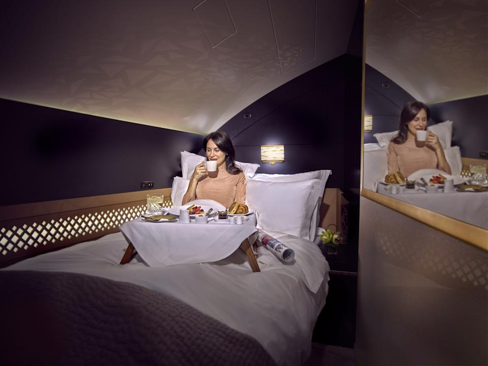 The suite comes complete with a double bed and luxury bedding. [Photo: Etihad]