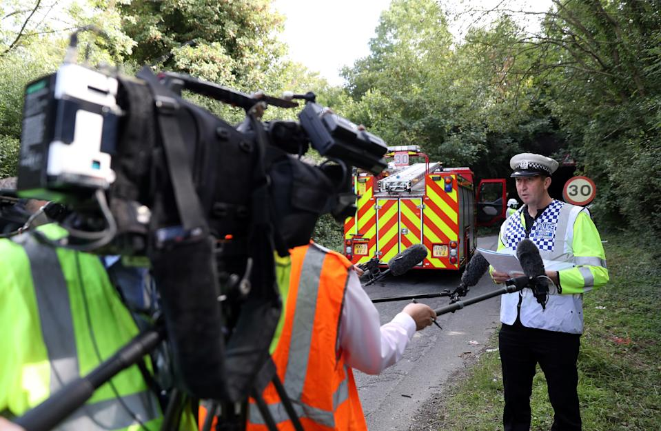 Inspector Andy Tester of the Hampshire Roads Policing Unit, reads a statement out to the press at the scene on Well House Lane in Winchester after three children were taken to hospital with serious injuries while 12 others suffered minor injuries after the school bus they were travelling in crashed into a railway bridge causing 'significant damage' to the top of the double-decker bus.