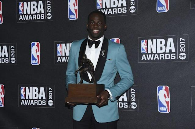 "<a class=""link rapid-noclick-resp"" href=""/nba/players/5069/"" data-ylk=""slk:Draymond Green"">Draymond Green</a> dressed boldly and accepted his first Defensive Player of the Year award. (AP)"