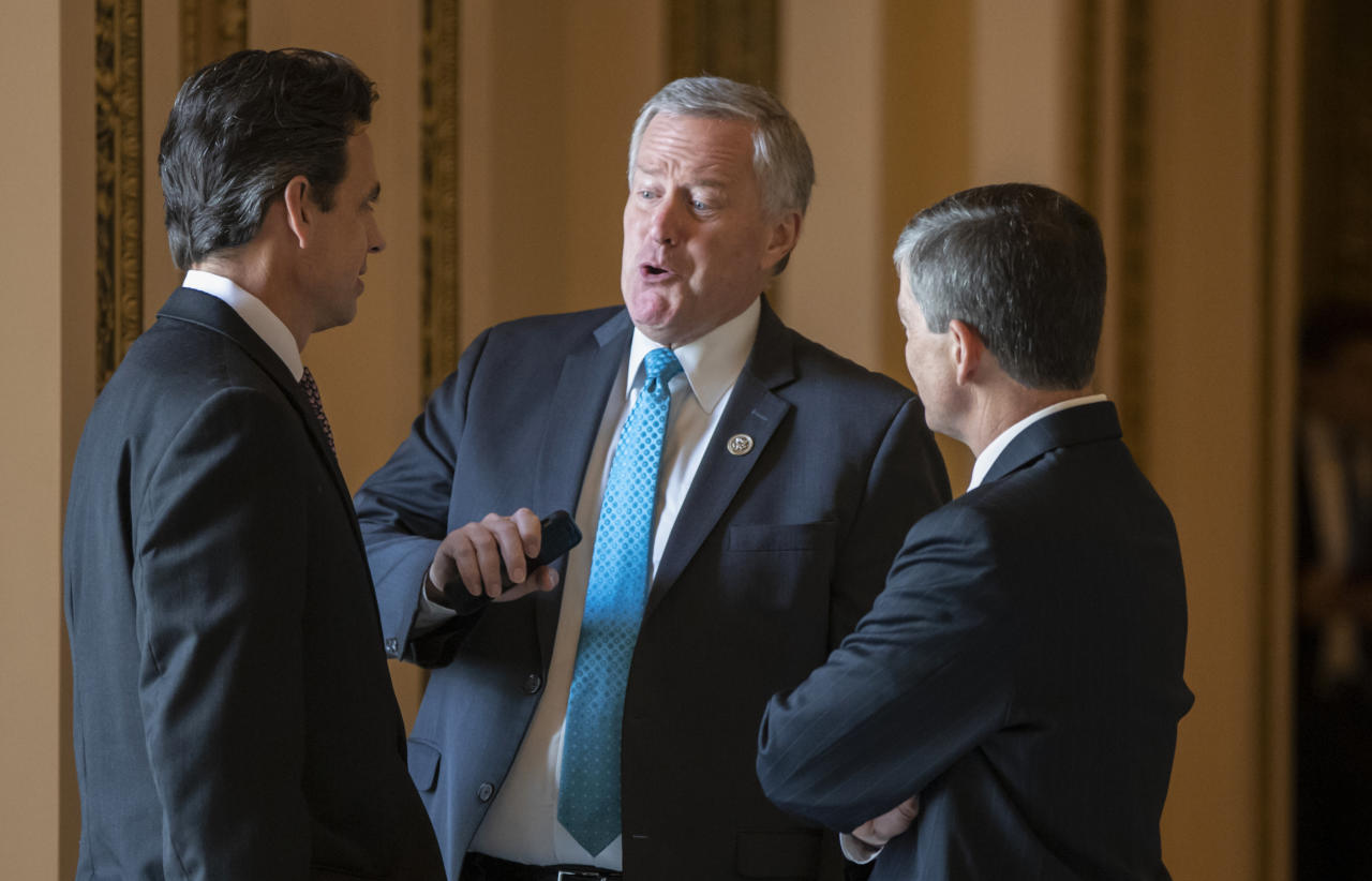 Rep. Mark Meadows, R-N.C., center, chairman of the conservative House Freedom Caucus, flanked by Rep. Tom Graves, R-Ga., Rep. Jeb Hensarling, R-Texas, talk before a series of votes in the House, at the Capitol in Washington, Thursday, June 21, 2018. Yesterday, Rep. Meadows and Speaker of the House Paul Ryan, R-Wis., faced off in the chamber as lawmakers struggled to move on immigration amid the political fallout of migrant families being separated at the border. (AP Photo/J. Scott Applewhite)