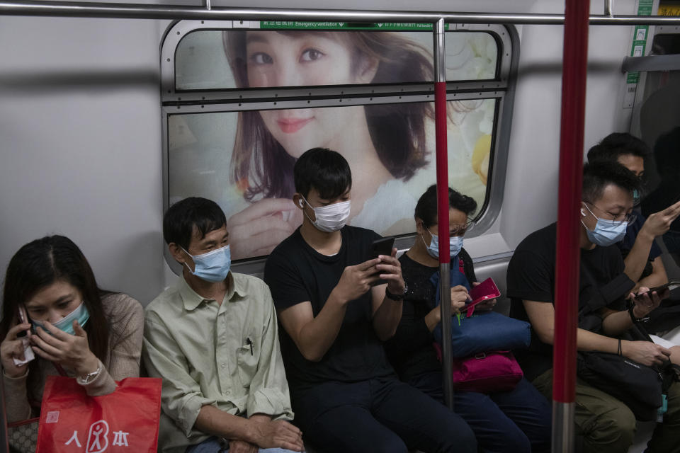 HONG KONG, CHINA - 2020/03/31: Commuters inside a tram wearing protective masks as a preventive measure against the spread of Coronavirus. Bars, Mah Jong clubs, gaming centers and parks have been closed for the next 14 days as well as avoid gatherings of more than 4 people. Hong Kong has so far reported 714 confirmed infected cases, and from those, 566 have been in the past 14 days. (Photo by Miguel Candela/SOPA Images/LightRocket via Getty Images)