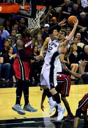 Jun 5, 2014; San Antonio, TX, USA; San Antonio Spurs center Tiago Splitter (22) shoots the ball against Miami Heat forward LeBron James (6) in game one of the 2014 NBA Finals at AT&T Center. Mandatory Credit: Soobum Im-USA TODAY Sports