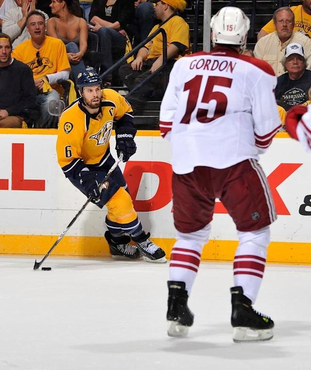 NASHVILLE, TN - MAY 02: Shea Weber #6 of the Nashville Predators carries the puck toward Boyd Gordon #15 of the Phoenix Coyotes in Game Three of the Western Conference Semifinals during the 2012 NHL Stanley Cup Playoffs at the Bridgestone Arena on May 2, 2012 in Nashville, Tennessee. (Photo by Frederick Breedon/Getty Images)