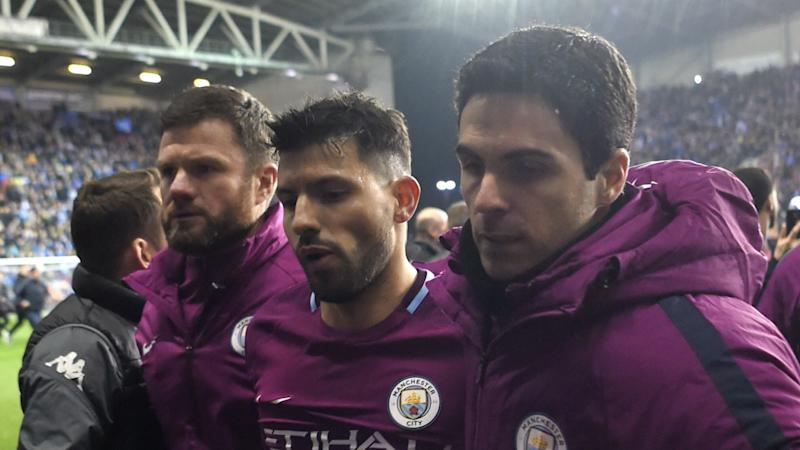Wigan charged after FA Cup pitch invasion following Manchester City win