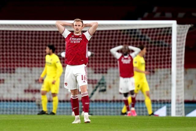 Rob Holding stands dejected as Villarreal beat Arsenal