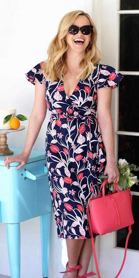 """<p>Reese Witherspoon dressed up for her birthday in a floral Draper James dress ($175; <a rel=""""nofollow"""" href=""""http://www.pntrac.com/t/8-10718-131940-134982?sid=IS,ResseWitherspoon,anesta,,IMA,3433895,201903,I&url=https%3A%2F%2Fdraperjames.com%2Fproducts%2Flinen-wrap-dress%3Fvariant%3D20565990506609"""">draperjames.com</a>), black sunglasses, and a leather reversible tote ($198; <a rel=""""nofollow"""" href=""""http://www.pntrac.com/t/8-10718-131940-134982?sid=IS,ResseWitherspoon,anesta,,IMA,3433895,201903,I&url=https%3A%2F%2Fdraperjames.com%2Fproducts%2Fleather-reversible-tote-coral"""">draperjames.com</a>).</p>"""