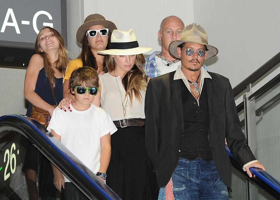 NARITA, JAPAN - JULY 18:  (R-L) Johnny Depp, Amber Heard, Jack Depp and Lily Rose Melody Depp are seen upon departure at Narita International Airport on July 18, 2013 in Narita, Japan.  (Photo by Jun Sato/WireImage)