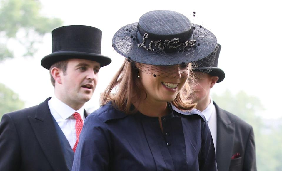 Princess Eugenie wore a hat emblazoned with the word 'love' at the Queen's garden party [Photo: Getty]