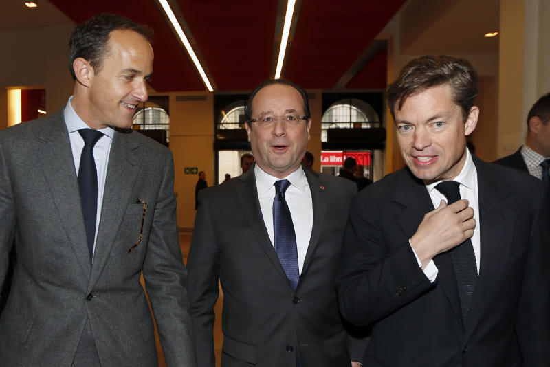 "French President Francois Hollande, center, is welcomed by Institute of Political Studies (IEP) or ""Sciences Po"" President Frederic Mion, left, and Berggruen Institute Chairman Nicolas Berggruen as he arrives for the ""Europe: next steps"" conference at the Institute of Political Studies in Paris, Tuesday, May 28, 2013. (AP Photo/Charles Platiau, Pool)"