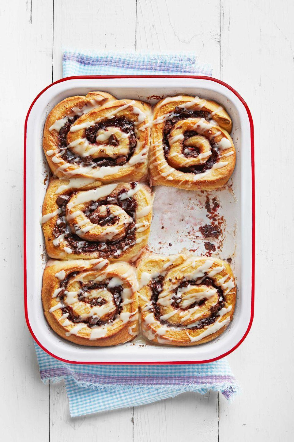 """<p>The smell of these decadent treats baking will have everyone out of bed in no time.<br></p><p><strong><a href=""""https://www.countryliving.com/food-drinks/recipes/a38954/chocolate-cherry-cinnamon-rolls-recipe/"""" rel=""""nofollow noopener"""" target=""""_blank"""" data-ylk=""""slk:Get the recipe"""" class=""""link rapid-noclick-resp"""">Get the recipe</a>.</strong></p>"""
