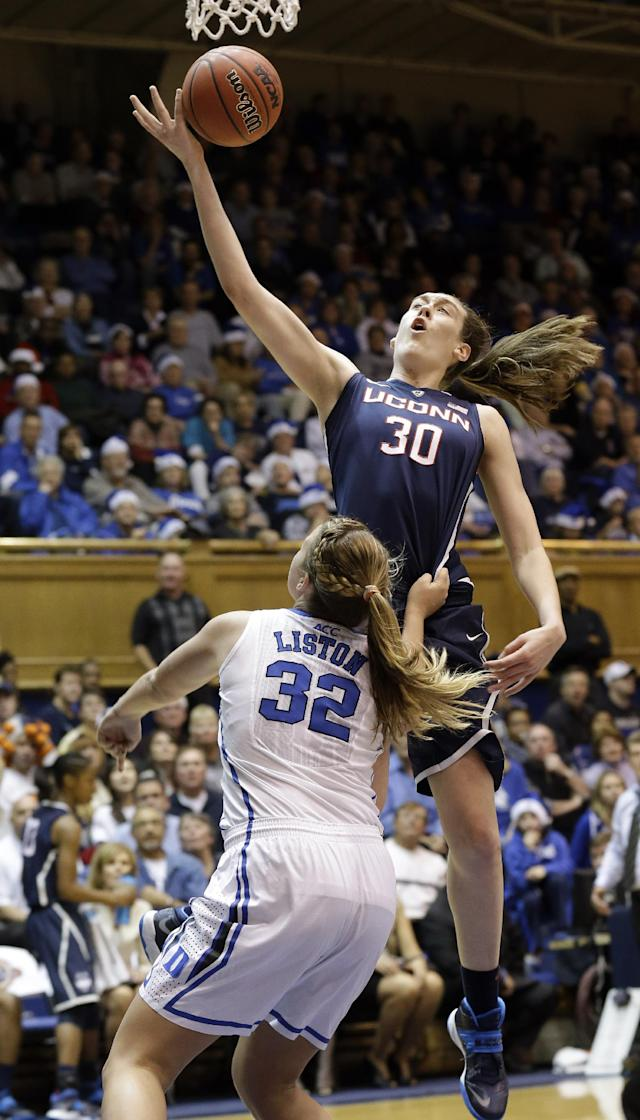 Connecticut's Breanna Stewart (30) drives to the basket as Duke's Tricia Liston (32) defends during the second half of an NCAA college basketball game in Durham, N.C., Tuesday, Dec. 17, 2013. Connecticut won 83-61.(AP Photo/Gerry Broome)
