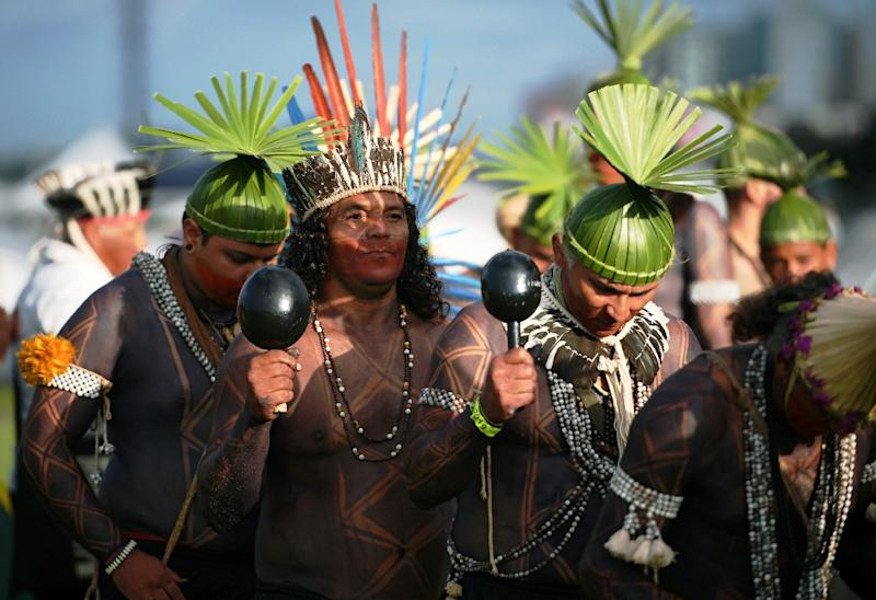 Indigenous people perform a ceremonial ritual (AFP Photo/CARL DE SOUZA)