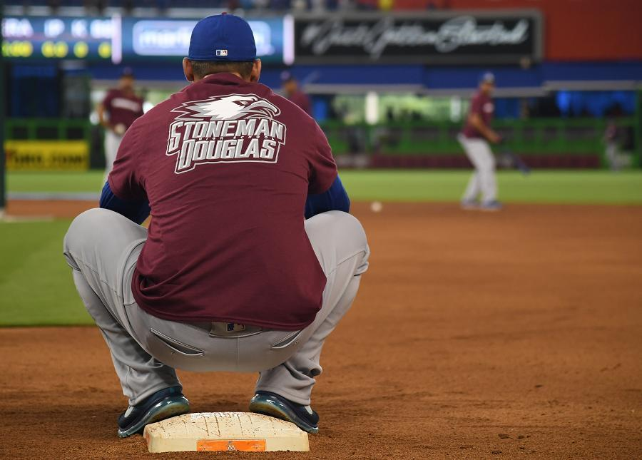 Cubs first baseman Anthony Rizzo wears a Stoneman Douglas t-shirt on opening day at Marlins Park. (Getty Images)