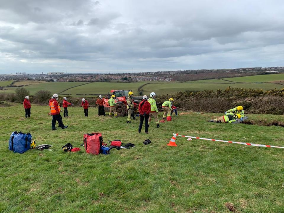 Cumbria Fire and Rescue Service pulled the farmer from the 60ft sinkhole (CFRS/Twitter)