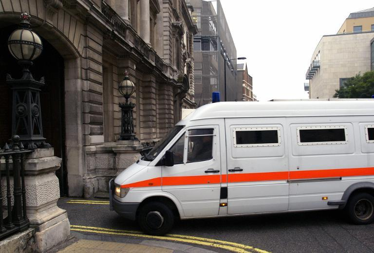An armored British prison van allegedly transporting suspected British terrorist Haroon Rashid Aswat for an extradition hearing enters London's Bow Street magistrate's court on October 6, 2005