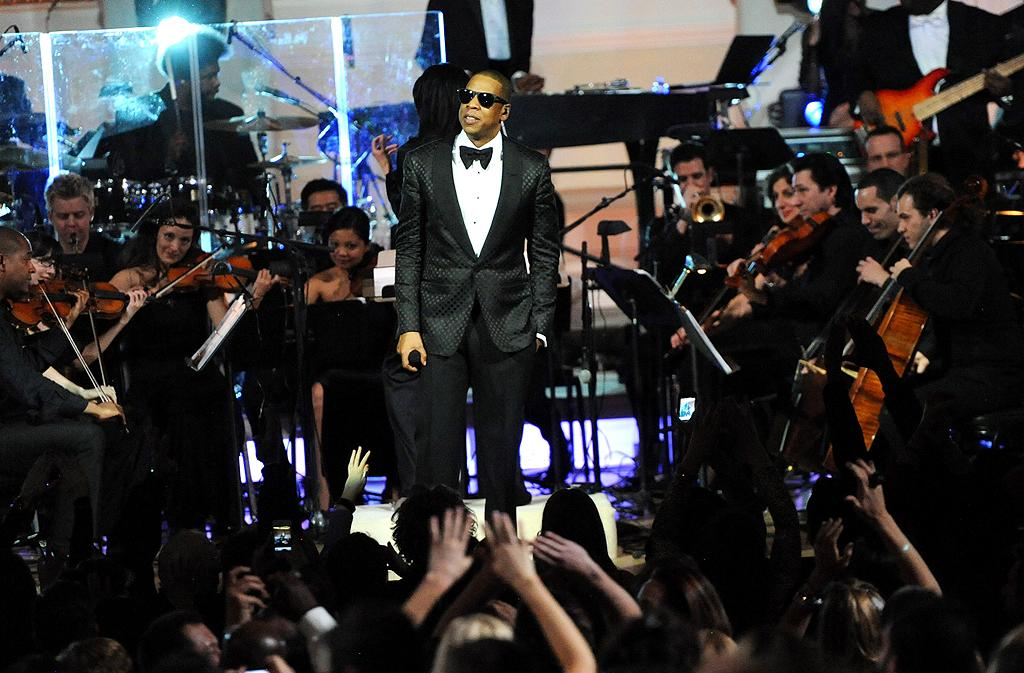 "Jay-Z looked dapper in a tuxedo and shades as he performed onstage at Carnegie Hall on Monday night with a 30-piece orchestra, who did a medley of Billy Joel's ""New York State of Mind,""  Frank Sinatra's ""New York, New York,"" and Gil Scott-Heron's ""New York Is  Killing Me."" The concert benefited the United Way of New York City and the Shawn Carter Foundation (2/6/2012)"