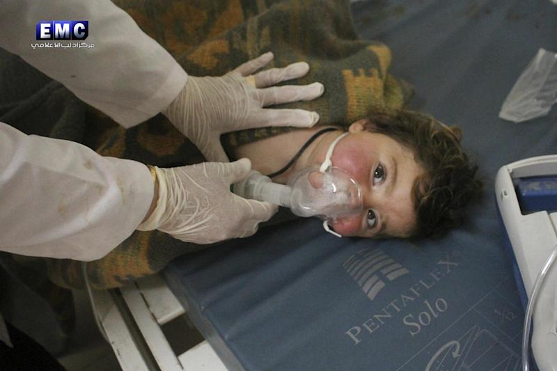 Hospital: A Syrian doctor treats a child following a chemical attack: AP