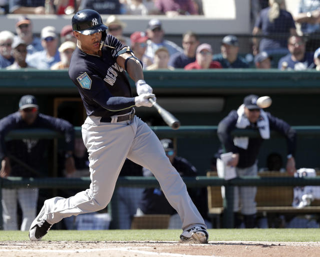 New York Yankees' Giancarlo Stanton hits a double in the fourth inning during a spring baseball exhibition game against the Detroit Tigers, Tuesday, March 6, 2018, in Lakeland, Fla. (AP Photo/John Raoux)