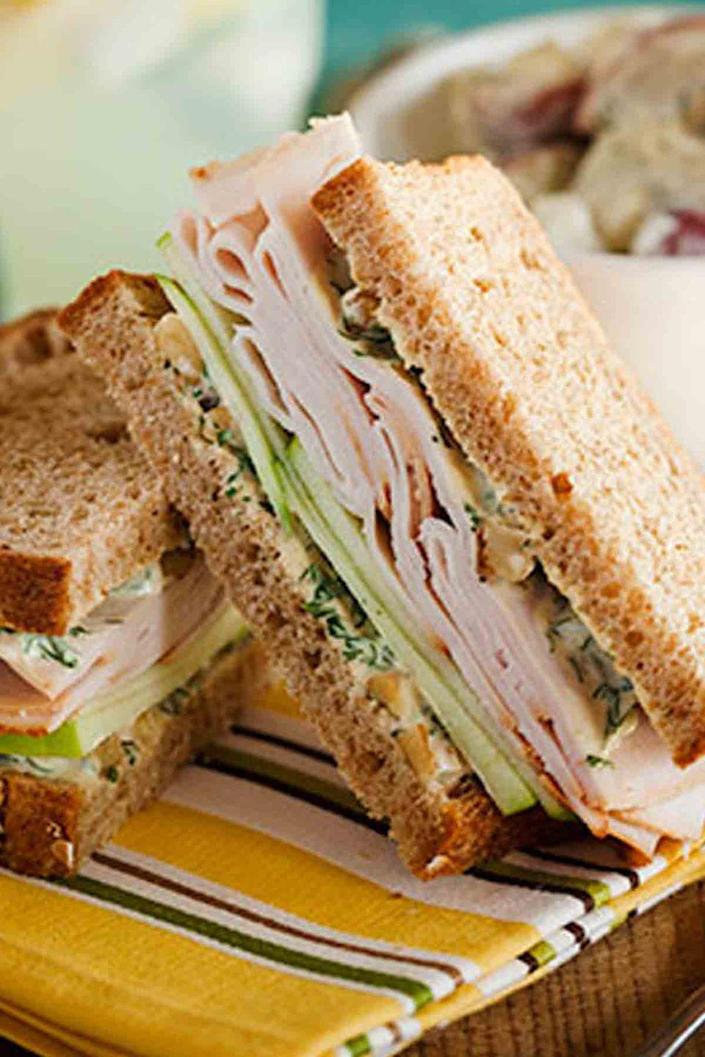 """<p>Mango chutney and curry give this turkey sandwich its sweet and exotic edge. It's also very easy to eat outside on a glorious spring day. <br></p><p><a href=""""https://www.womansday.com/food-recipes/food-drinks/recipes/a12571/curried-turkey-apple-watercress-sandwich-recipe-wdy1113/"""" rel=""""nofollow noopener"""" target=""""_blank"""" data-ylk=""""slk:Get the recipe for Curried Turkey, Apple, and Watercress Sandwich."""" class=""""link rapid-noclick-resp""""><u><em>Get the recipe for Curried Turkey, Apple, and Watercress Sandwich.</em></u></a></p>"""
