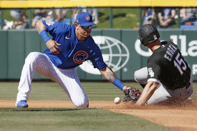 Chicago White Sox center fielder Adam Engel (15) steals second base as Chicago Cubs shortstop Hernan Perez, left, loses the ball in the fourth inning of a spring training baseball game, Friday, March 6, 2020, in Mesa, Ariz. (AP Photo/Sue Ogrocki)