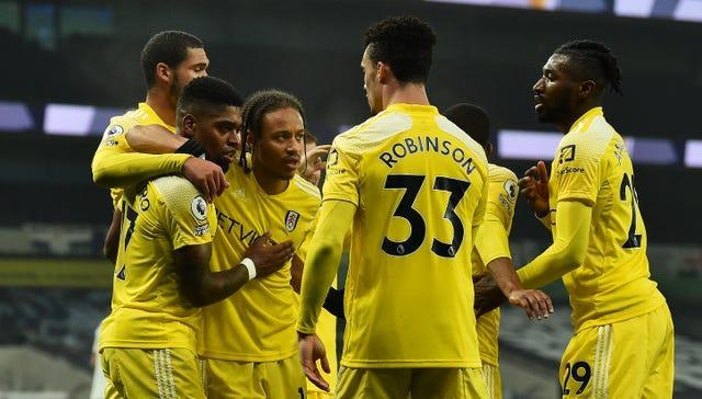 Fulham players celebrating with Ivan Cavaleiro (2nd left) after his goal.