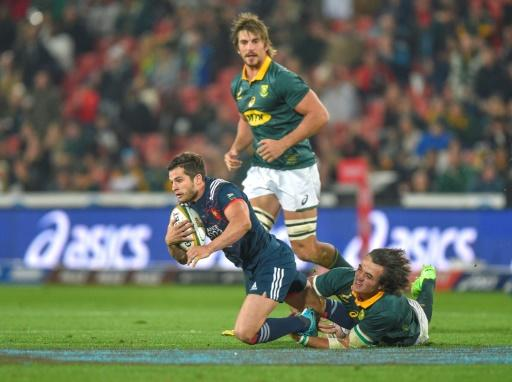 Brice Dulin of France (L) is tackled by Franco Mostert of South Africa during the third rugby union test match at Emirates Airline Park in Johannesburg, on June 24, 2017