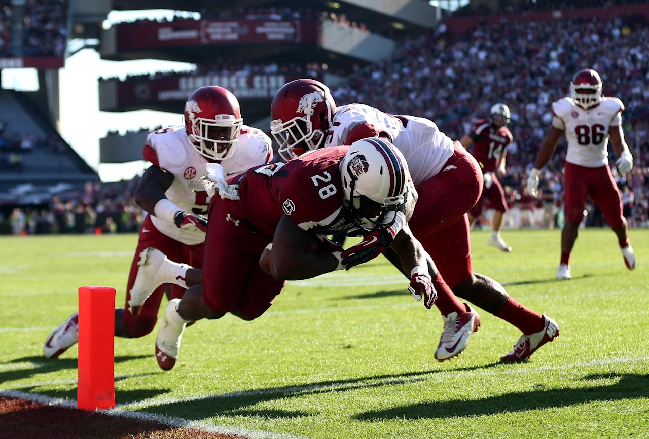 COLUMBIA, SC - NOVEMBER 10:  Mike Davis #28 of the South Carolina Gamecocks dives for a touchdown against the defense of the Arkansas Razorbacks during their game at Williams-Brice Stadium on November 10, 2012 in Columbia, South Carolina.  (Photo by Streeter Lecka/Getty Images)
