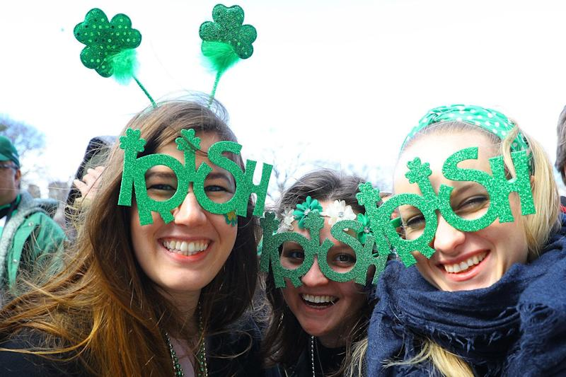 Three women pose for a photo wearing festive eyewear during the St. Patrick's Day Parade, March 16, 2019, in New York. (Photo: Gordon Donovan/Yahoo News)