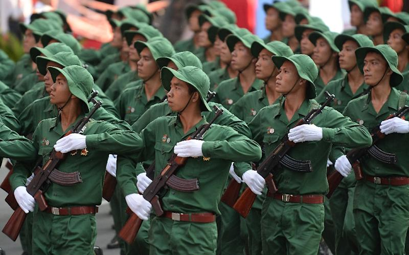 Soldiers dressed as Vietnam War era Vietcong soldiers march during a parade marking the 40th anniversary of the fall of Saigon, in Ho Chi Minh City on April 30, 2015 (AFP Photo/Hoang Dinh Nam)