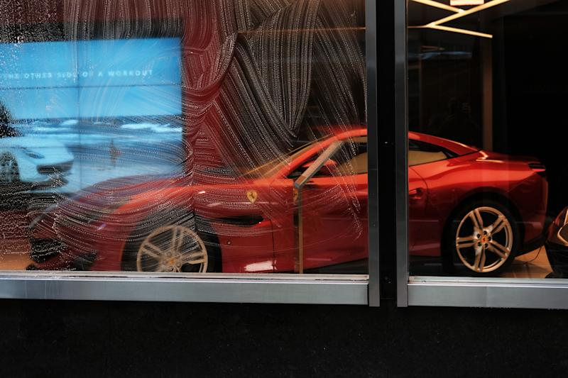 NEW YORK, NEW YORK - NOVEMBER 04: Cars are displayed at a Ferrari dealer on Park Avenue in Manhattan on November 04, 2019 in New York City. Following the reporting of strong third quarter results, the Italian luxury carmaker has increased its outlook on 2019 revenue to about 3.7 billion euros. Ferrari has been seeing strong sales of its Portofino and 812 Superfast models. (Photo by Spencer Platt/Getty Images)
