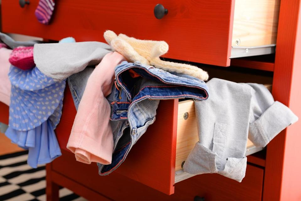 """Before you start reorganizing any part of your home, be sure to clear the area first and assess your possessions. So, if you're decluttering your closet, take all—and we mean <em>all</em>—of your clothes out and put them in a pile on your bed. If you're making space in your kitchen cabinets, take out all of the plates and glasses and line them up on a counter. """"You have to see all 30 pairs of scissors to realize how many excess items you have,"""" says professional organizer <strong>Katy Winter</strong>, founder of <a href=""""https://www.katysorganizedhome.com"""" rel=""""nofollow noopener"""" target=""""_blank"""" data-ylk=""""slk:Katy's Organized Home"""" class=""""link rapid-noclick-resp"""">Katy's Organized Home</a>, which serves New York City and Miami."""