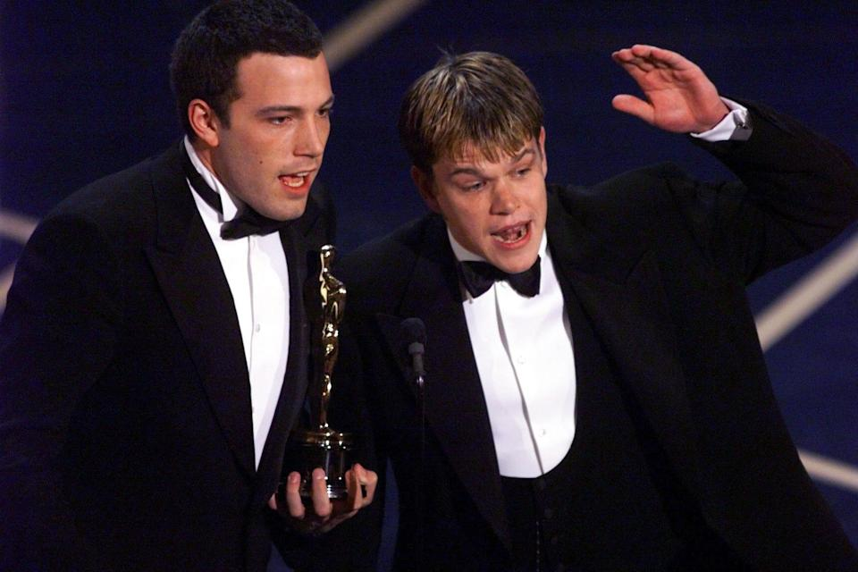 """Ben Affleck, left, and Matt Damon accept the original screenplay Oscar for """"Good Will Hunting"""" at the 70th Academy Awards in 1998. The friends have reunited as a writing pair for the new drama """"The Last Duel."""""""